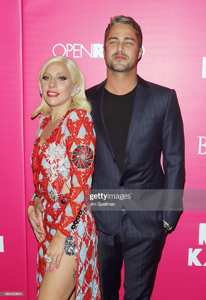 Singer/songwriter Lady Gaga and actor Taylor Kinney attend the 'Rock The Kasbah' New York premiere at AMC Loews Lincoln Square on October 19, 2015 in New York City.