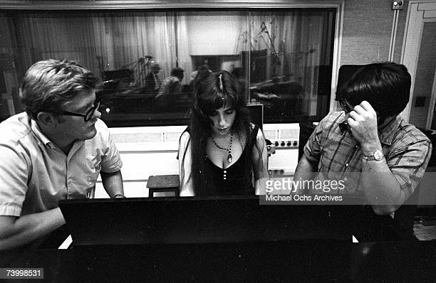 Singer/songwriter Laura Nyro records in the studio with fellow songwriter Stephen Sondheim on October 3 1968 in New York City New York