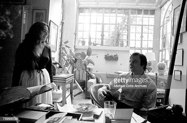 Singer/songwriter Laura Nyro relaxes at an apartment with fellow songwriter Stephen Sondheim on October 3 1968 in New York City New York