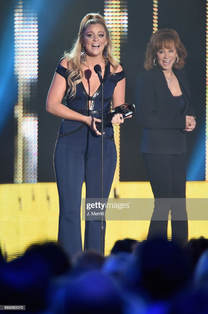 Singer-songwriter Lauren Alaina (L) accepts an award onstage from Reba McEntire (R) at the 2017 CMT Music Awards at the Music City Center on June 7, 2017 in Nashville, Tennessee.