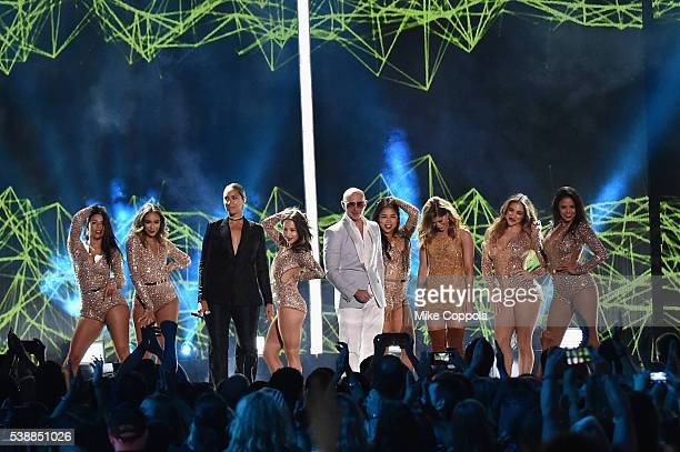 Singersongwriter Leona Lewis Rapper Pitbull and singersongwriter Cassadee Pope onstage during the 2016 CMT Music awards at the Bridgestone Arena on...