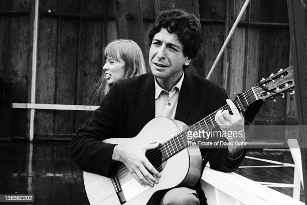 Singersongwriter Leonard Cohen backstage with Joni Mitchell before a performance at the 1967 Newport Folk Festival in Newport Rhode Island