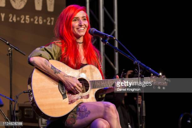 Singer/songwriter Lights performs on stage at the Taylor Guitars booth at NAMM Show at Anaheim Convention Center on January 24 2019 in Anaheim...