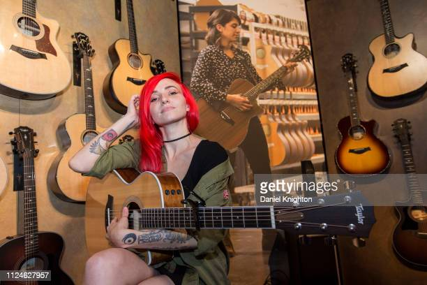 Singer/songwriter Lights poses at the Taylor Guitars booth at NAMM Show at Anaheim Convention Center on January 24 2019 in Anaheim California