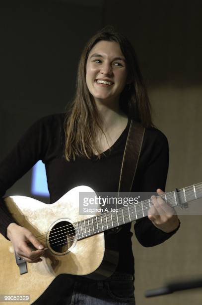 Singer-songwriter Liz Carlisle performs at a benefit concert for South Shore Habitat for Humanity at the Mozaic Room Coffeehouse in the Avon Baptist...