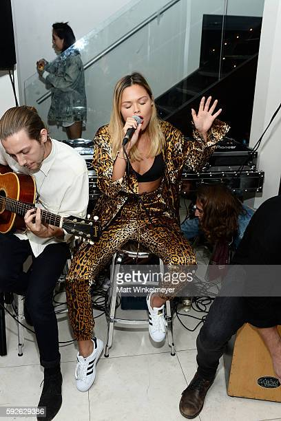 Singersongwriter Liza Owen performs during the ARYA Curcumin Presents The Yellow Social at Private Residence on August 20 2016 in Los Angeles...