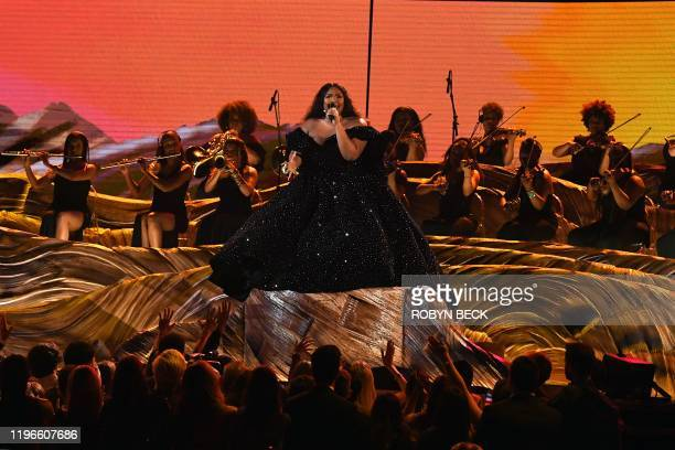 TOPSHOT US singersongwriter Lizzo performs onstage during the 62nd Annual Grammy Awards on January 26 in Los Angeles