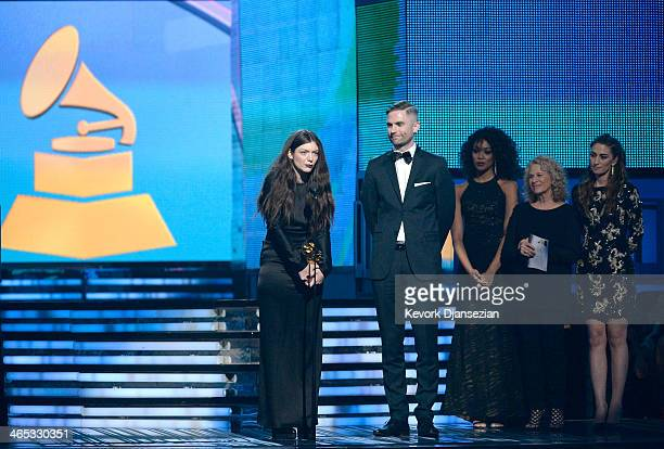 Singer/songwriter Lorde and songwriter Joel Little accept the Song of the Year award for 'Royals' with musicians Carole King and Sara Bareilles...
