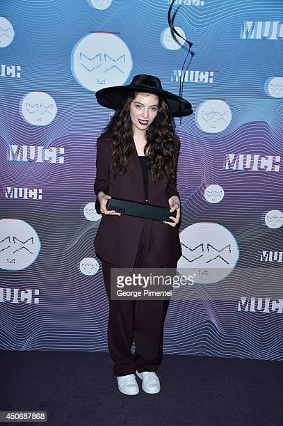 Singersongwriter Lorde poses in the press room at the 2014 MuchMusic Video Awards at MuchMusic HQ on June 15 2014 in Toronto Canada