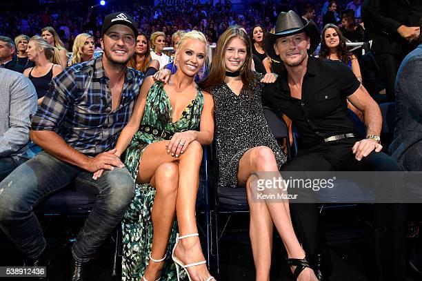 Singersongwriter Luke Bryan Caroline Boyer and singersongwriter Tim McGraw attends the 2016 CMT Music awards at the Bridgestone Arena on June 8 2016...
