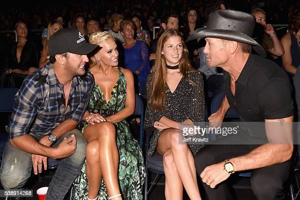 Singersongwriter Luke Bryan Caroline Boyer Maggie McGraw and singersongwriter Tim McGraw attend the 2016 CMT Music awards at the Bridgestone Arena on...
