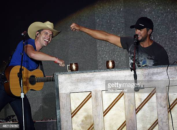 Singer/Songwriter Luke Bryan is joined onstage by Dustin Lynch at Country Thunder Day 4 In Twin Lakes Wisconsin on July 26 2015 in Twin Lakes...