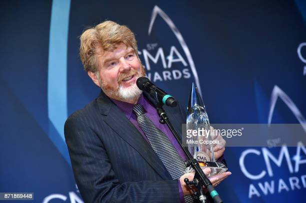 SingerSongwriter Mac McAnally poses in the press room at the 51st annual CMA Awards at the Bridgestone Arena on November 8 2017 in Nashville Tennessee