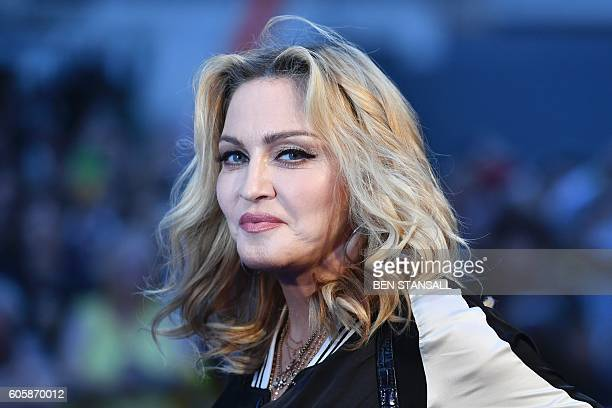 US singersongwriter Madonna poses arriving on the carpet to attend a special screening of the film 'The Beatles Eight Days A Week The Touring Years'...