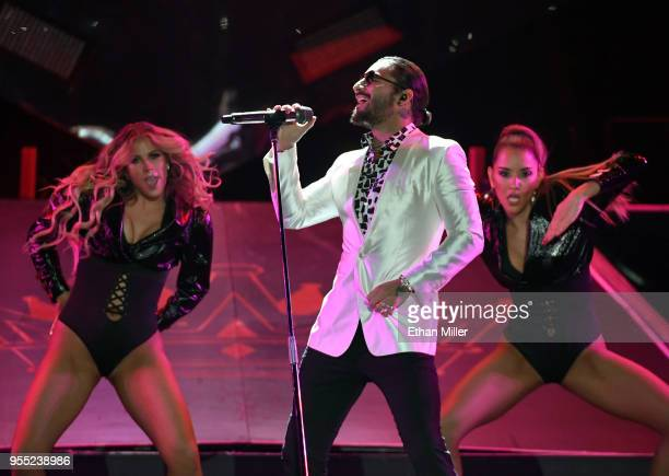 Singer/songwriter Maluma performs with dancers at the Mandalay Bay Events Center in support of his upcoming album 'FAME' on May 5 2018 in Las Vegas...