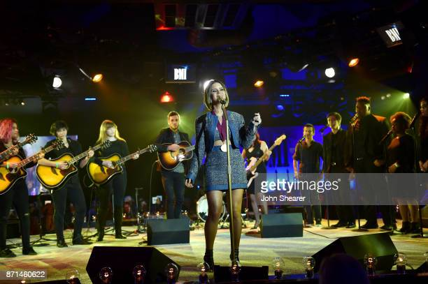 Singersongwriter Maren Morris performs with the Nashville School of the Arts choir onstage during the 65th Annual BMI Country Awards at BMI on...