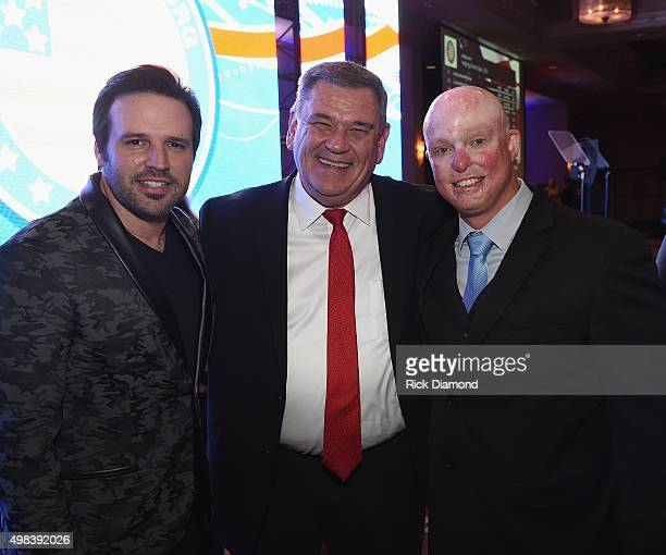 Singer/Songwriter Mark Wills, Executive Director Helping a Hero Bob Clark and Veteran Blaine Street attend the 2015 Helping A Hero Gala on November...