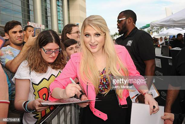 Singer/songwriter Meghan Trainor poses with fans at Y100's Jingle Ball Village Y100's Jingle Ball 2014 official preshow at BBT Center on December 21...