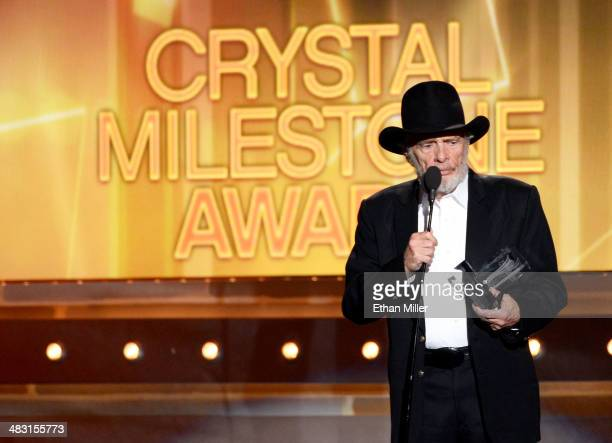 Singer/songwriter Merle Haggard accepts the ACM Crystal Milestone Award onstage during the 49th Annual Academy of Country Music Awards at the MGM...