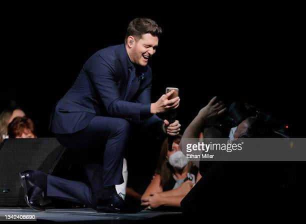 Singer/songwriter Michael Buble shows the audience a video message he made to convince a group of local health care workers that his concert...