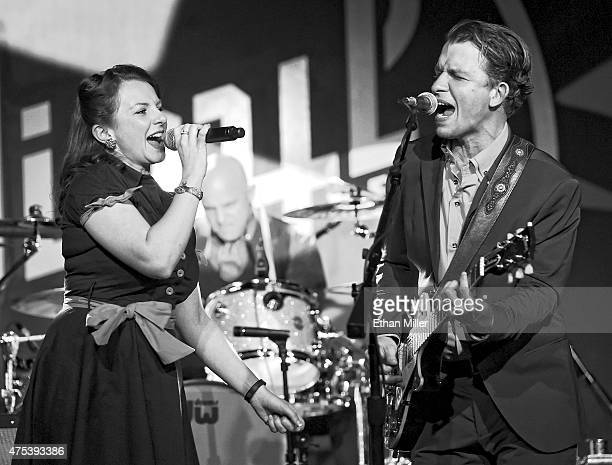 Singer/songwriter Michael Grimm of Grimm performs with his wife and manager Lucie Grimm during the launch of the band's threemonth residency at Vinyl...