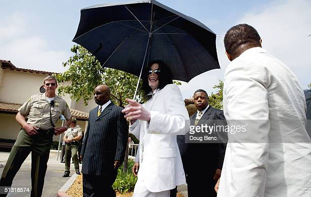 Singer/songwriter Michael Jackson and brother Randy Jackson leave court on September 17 2004 in Santa Maria California