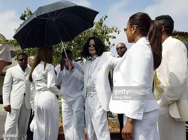 Singer/songwriter Michael Jackson and his family leave court on September 17 2004 in Santa Maria California