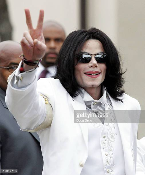 Singer/songwriter Michael Jackson waves to fans as he arrives for court on September 17 2004 in Santa Maria California