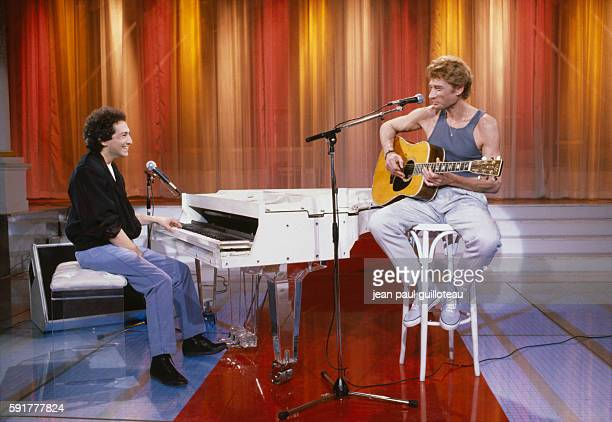 Singersongwriter Michel Berger and singer Johnny Hallyday on the set of TV variety program ChampsElysées