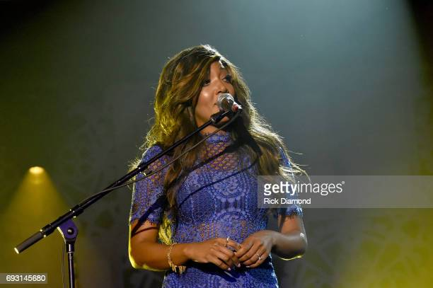 Singersongwriter Mickey Guyton performs onstage at the Innovation In Music Awards on June 6 2017 in Nashville Tennessee
