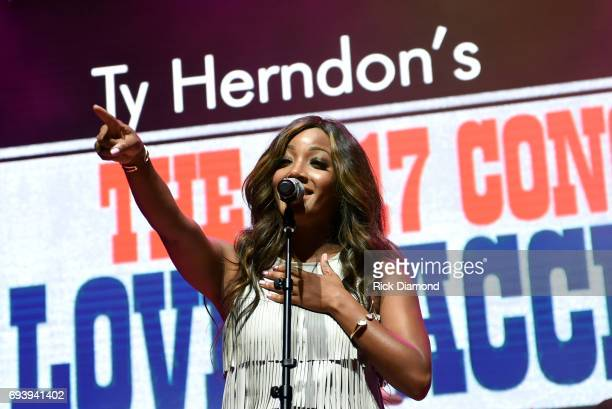 Singersongwriter Mickey Guyton performs onstage during the 2017 Concert for Love Acceptance on June 8 2017 in Nashville Tennessee