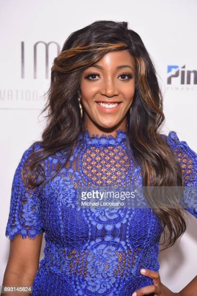 Singersongwriter Mickey Guyton poses backstage at the Innovation In Music Awards on June 6 2017 in Nashville Tennessee