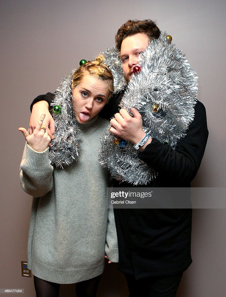 Singer/songwriter Miley Cyrus (L) and musician Joe Newman attend day two of the 25th annual KROQ Almost Acoustic Christmas at The Forum on December 13, 2014 in Inglewood, California.