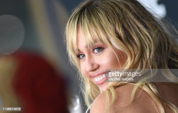 """Singer/songwriter Miley Cyrus arrives for the World premiere of Marvel Studios' """"Avengers: Endgame"""" at the Los Angeles Convention Center on April 22,..."""