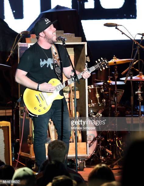 Singersongwriter Mitchell Tenpenny performs on stage opening for Dustin Lynch during The Ride or Die Tour at PlayStation Theater on December 2 2017...