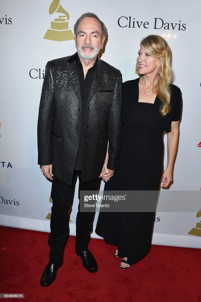 Singer-songwriter Neil Diamond (L) and Katie McNeil attend Pre-GRAMMY Gala and Salute to Industry Icons Honoring Debra Lee at The Beverly Hilton on February 11, 2017 in Los Angeles, California.