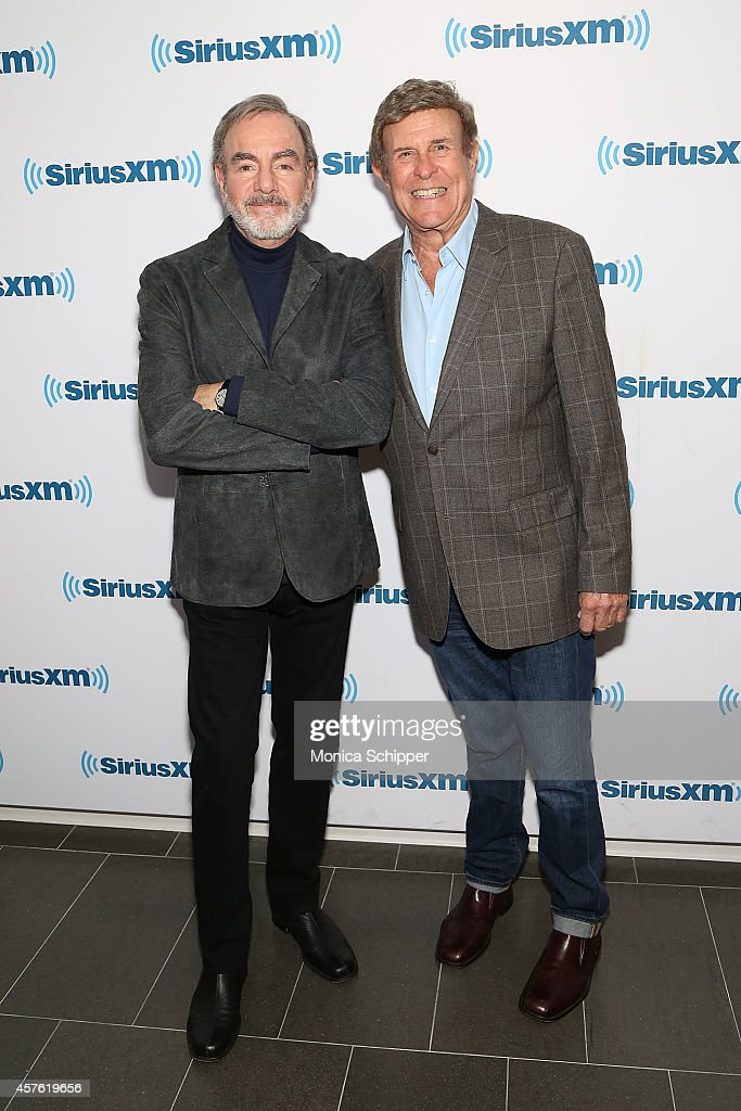 Singer-songwriter Neil Diamond (L) and radio personality Bruce 'Cousin Brucie' Morrow visit the SiriusXM Studios on October 21, 2014 in New York City.