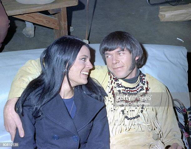 Singer/Songwriter Neil Young of the group Buffalo Springfield poses for a portrait with a woman at Gold Star Recording Studios in 1966 in Los Angeles...