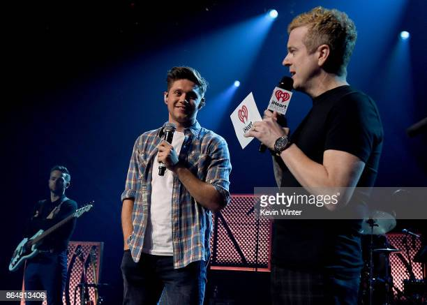 Singer/songwriter Niall Horan and iHeart Radio DJ JoJo Wright speak onstage at the iHeartRadio Album Release Party With Niall Horan at iHeartRadio...