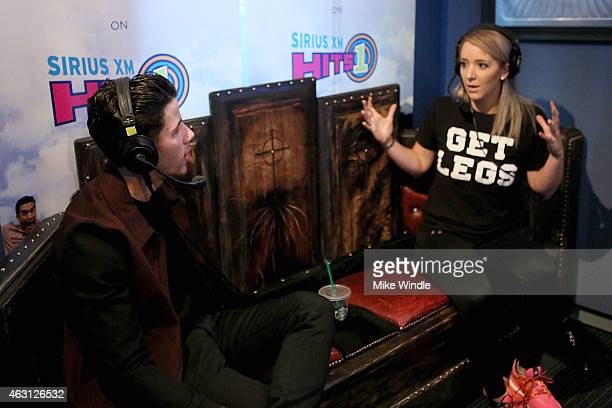 Singersongwriter Nick Jonas and YouTube personality Jenna Marbles attend Hits 1's The Morning Mash Up Broadcast from the SiriusXM Studios on February...