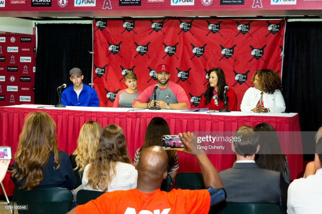 Singer-songwriter Nick Jonas, Deidre Pujols, Albert Pujols, Susan Kang Schroeder and Survivor Advocate Stacy Jewell attend the Strike Out Slavery Press Conference at Angel Stadium on August 9, 2018 in Anaheim, California.