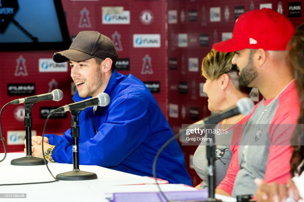 Singer-Songwriter Nick Jonas, Deidre Pujols and Albert Pujols attend the Strike Out Slavery Press Conference at Angel Stadium on August 9, 2018 in Anaheim, California.