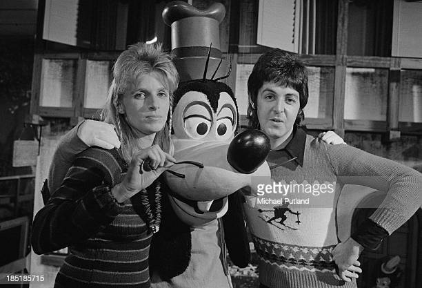 Singersongwriter Paul McCartney and his wife Linda of British rock group Wings with Disney character Goofy November 1973