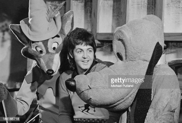 Singersongwriter Paul McCartney of British rock group Wings with Disney characters Robin Hood and Pluto November 1973