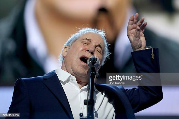 Singersongwriter Paul Simon performs on stage during the first day of the Democratic National Convention at the Wells Fargo Center July 25 2016 in...