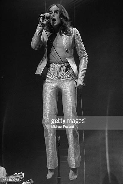 Singersongwriter Peter Gabriel suspended above the stage during a performance with English progressive rock group Genesis at the Theatre Royal Drury...