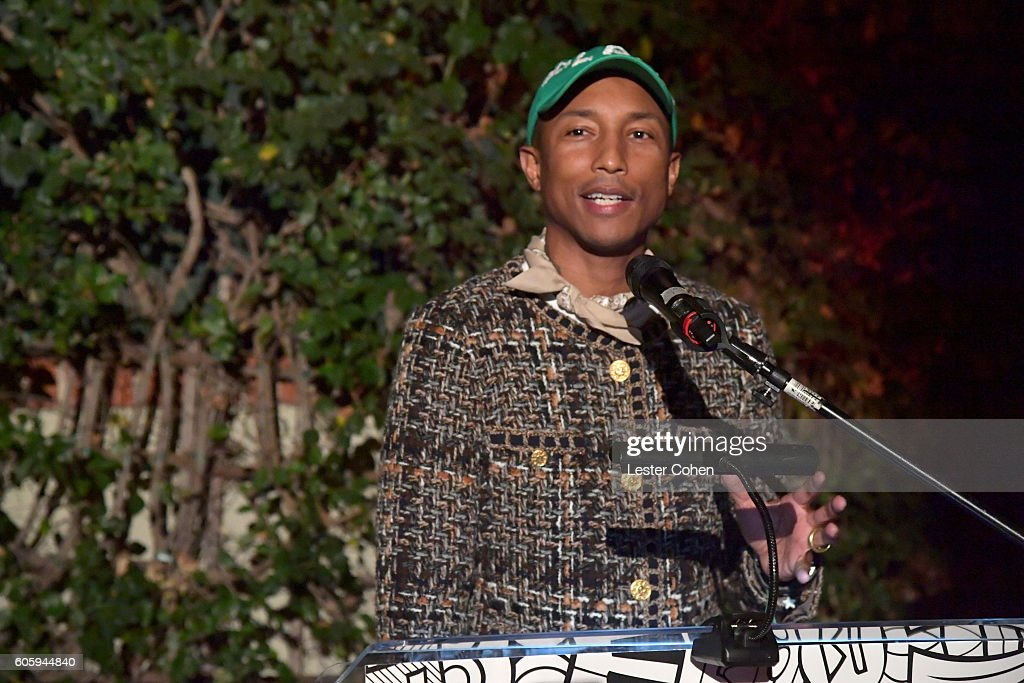 Singer-songwriter Pharrell Williams accepts the 'Clive Davis Legend in Songwriting Award' during Songs Of Hope at a private residence on September 15, 2016 in Brentwood, California.