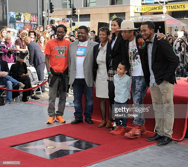 Singer/songwriter Pharrell Williams and family at the Hollywood Walk Of Fame Ceremony honoring Pharrell Williams on December 4 2014 in Hollywood...