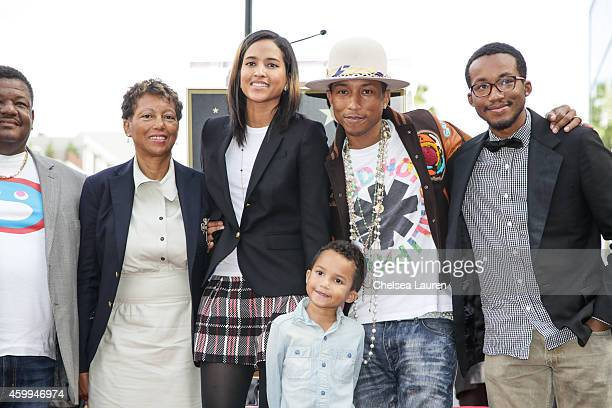 SingerSongwriter Pharrell Williams and family attend the ceremony honoring Pharrell Williams with a star on the Hollywood Walk of Fame on December 4...