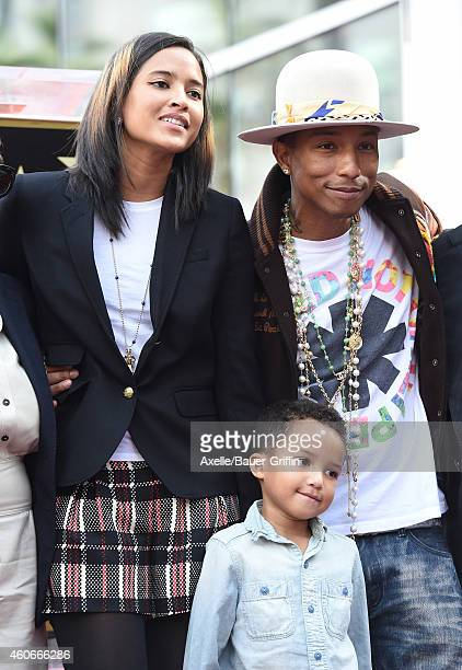 Singersongwriter Pharrell Williams wife Helen Lasichanh and son Rocket Ayer Williams attend the ceremony honoring Pharrell Williams with a Star on...